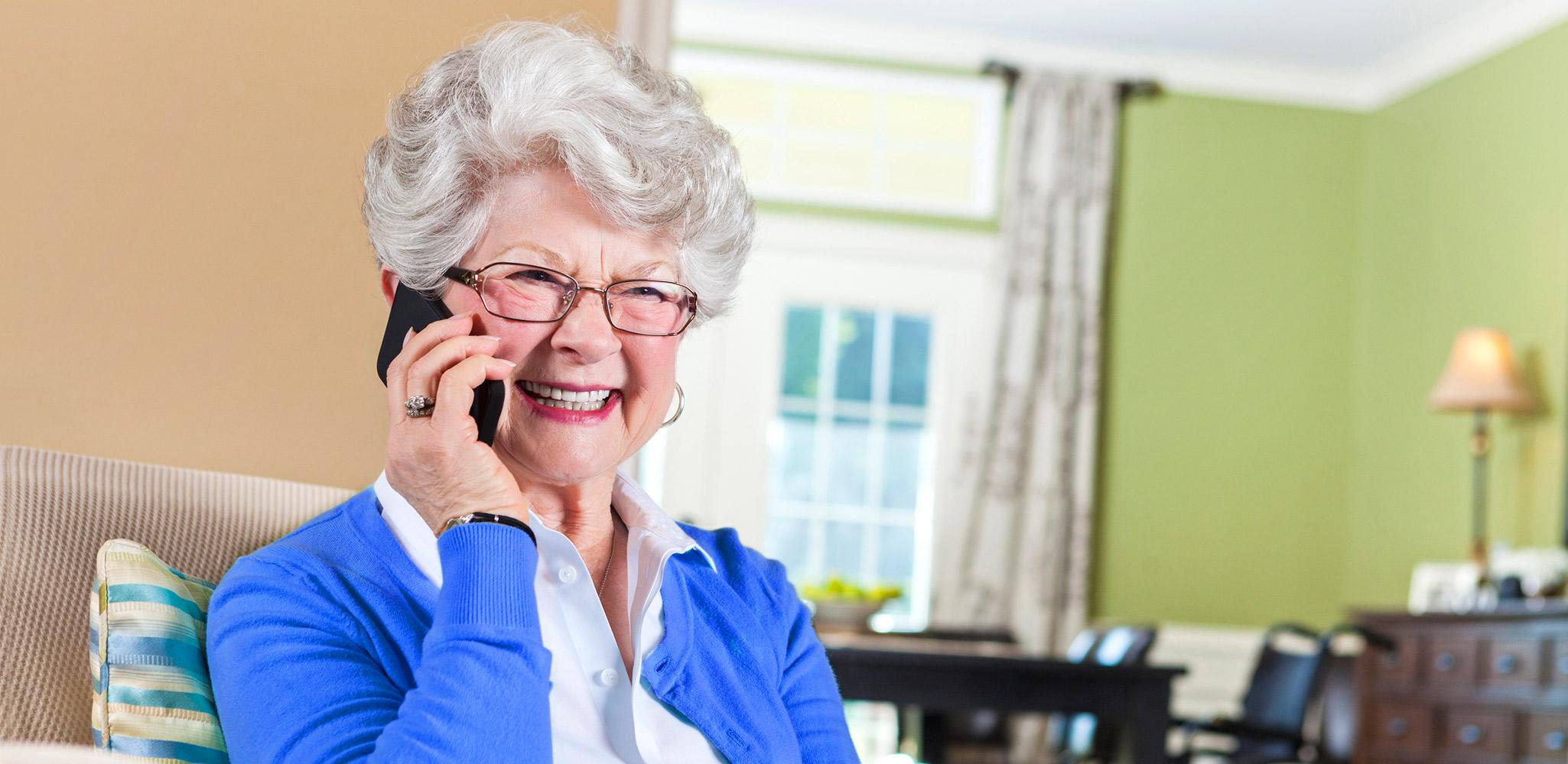 Happy Alpine Communications Wireless customer mature woman