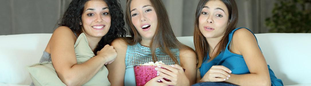 teen girls on couch enjoying Alpine Communications FusionTV