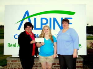 Pictured are Lori Keppler, Alpine customer service manager; Elizabeth Roach; and Margaret Corlett, Alpine Finance manager.