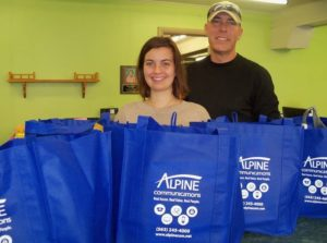 Pictured are Molly Moser, The Guttenberg Press;and Tom Hyde, Alpine Communications. Photo courtesy of The Guttenberg Press.