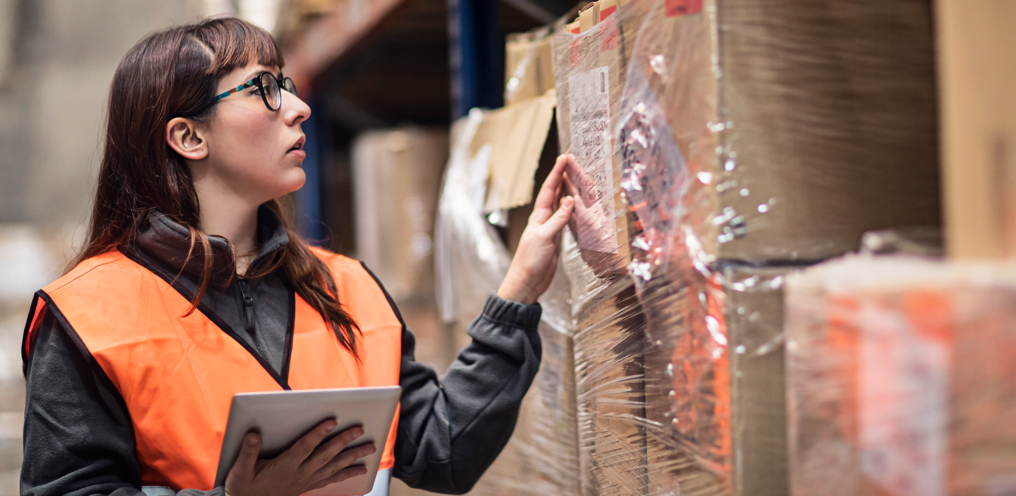 Woman in warehouse - Business solutions for communication- Alpine Communications Elkader IA