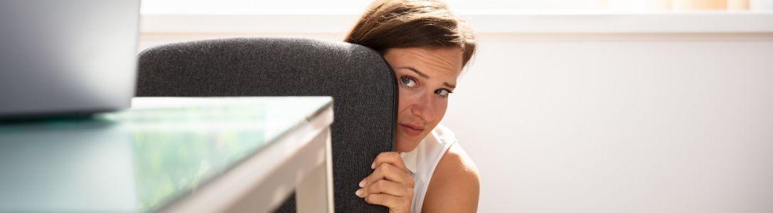 Panic Button Woman Hiding Behind Desk